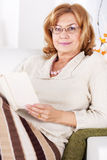 Senior woman in home Royalty Free Stock Image
