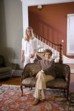 Senior woman at home on sofa with adult daughter Royalty Free Stock Photo