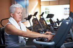 Senior woman on home trainer Royalty Free Stock Photography