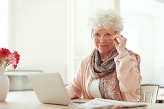 Senior Woman at Home Using a Laptop Stock Images