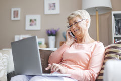 Senior woman at home. Using from new technology is easier and faster stock photo