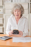 Senior woman horror purse royalty free stock photography