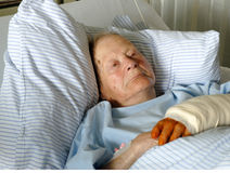Senior woman in hospital. Senior woman has a broken arm and is embittered Stock Photo