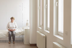Senior woman in hospital room Stock Photo