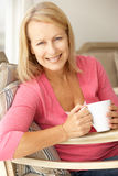 Senior woman with hot drink Royalty Free Stock Image