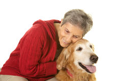 Senior Woman Hugging Her Golden Retriever Royalty Free Stock Photography
