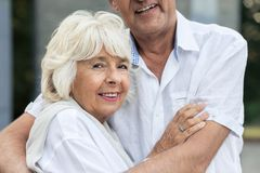 Senior woman hugging her husband Royalty Free Stock Photography