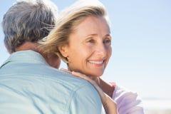 Senior woman hugging her partner Stock Photos