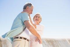 Senior woman hugging her partner Stock Images