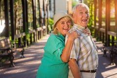 Senior woman hugging man. Royalty Free Stock Photography