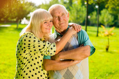 Senior woman hugging man. Stock Photos