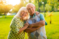 Senior woman hugs man. Stock Photos