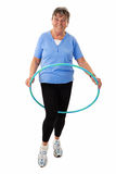 Senior woman with hula-hoop Stock Images
