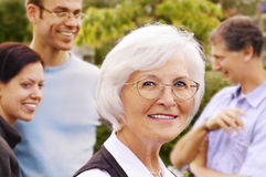 Senior Woman In Front Of Young People Group Stock Photography