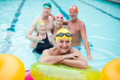 Senior woman by inflatable rings with friends royalty free stock photos