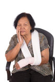 Senior woman with an injured arm wrapped in an Elastic Bandage Stock Images