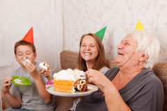 Senior woman and its grandsons with birthday cake Stock Image