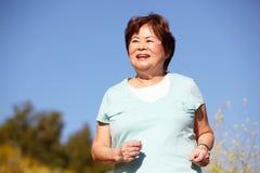 Senior woman jogging Royalty Free Stock Photography
