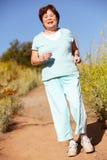 Senior woman jogging Stock Image