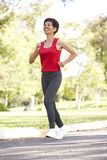 Senior Woman Jogging In Park Royalty Free Stock Photo