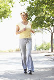 Senior Woman Jogging In Park stock photo