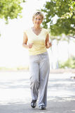Senior Woman Jogging In Park Royalty Free Stock Image