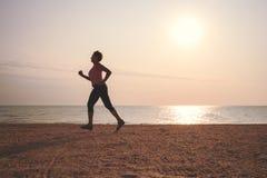 Senior woman jogging on sea beach Royalty Free Stock Photography