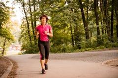 Senior woman jogging royalty free stock image