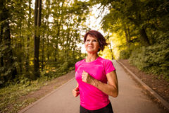Senior woman jogging Stock Images