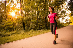 Senior woman jogging Stock Image