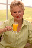 Senior woman with juice Stock Photo