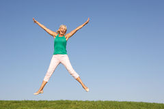 Senior woman  jumping in air Stock Photos