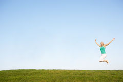 Senior woman jumping in air Stock Images