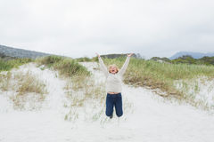 Senior woman jumping at beach Royalty Free Stock Image
