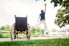 Senior Woman Jumping Up From Wheelchair Royalty Free Stock Image