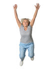 Senior woman jumping. On a white background Stock Image