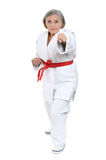 Senior woman in karate pose Royalty Free Stock Photography