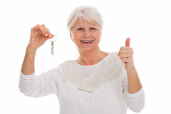 Senior woman with keys to new home Stock Photography