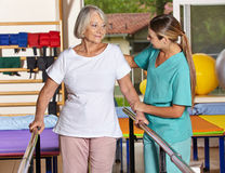 Senior woman at kinesiotherapy Stock Images
