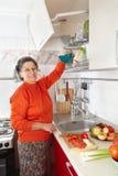Senior woman in the kitchen Stock Photos