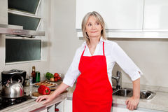 Senior woman in kitchen Royalty Free Stock Photography