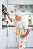 Senior woman  in the kitchen Royalty Free Stock Images