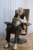 Senior Woman knitting Stock Photo