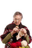 Senior woman knitting Royalty Free Stock Images