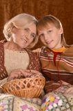 Senior woman knitting with grandson Royalty Free Stock Image