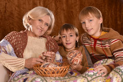 Senior woman knitting with grandsons Royalty Free Stock Photo