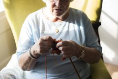 Senior woman knitting for hobby at home Stock Photos
