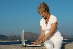 Senior woman laptop royalty free stock image