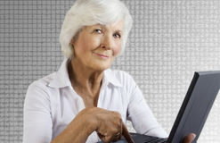 Senior woman and laptop Stock Photo