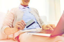 Senior woman with laptop and credit card at home Stock Photography
